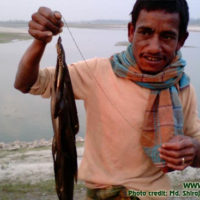 A fisherman showing his catch