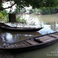 ঘাটে বাঁধা নৌকা পাশেই সনাতন (traditional) শৌচাগার